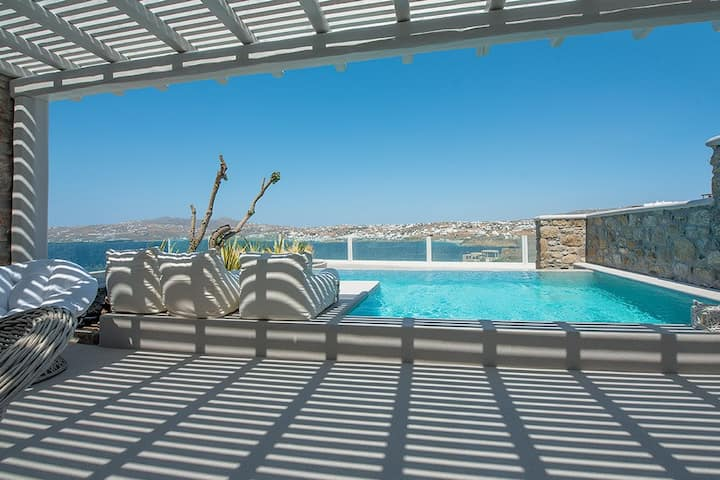 Relax in your private pool, gazing Mykonos