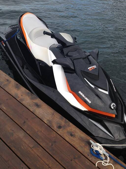 Rental jet ski docked out front on marina