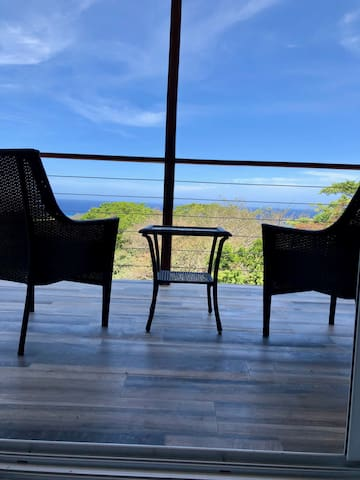 Relax on your private deck, overlooking the jungle and the Caribbean Sea. Perfect for enjoying a Honduran coffee in the morning and breathtaking sunsets in the evening.