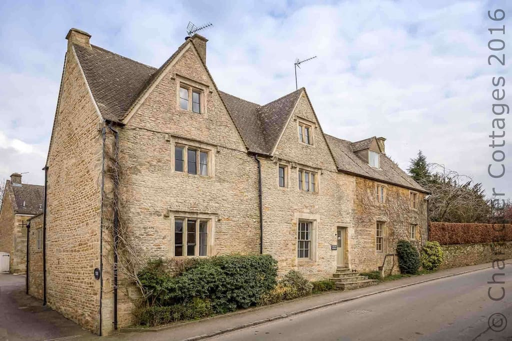 The front elevation, as seen from the quiet road through the village