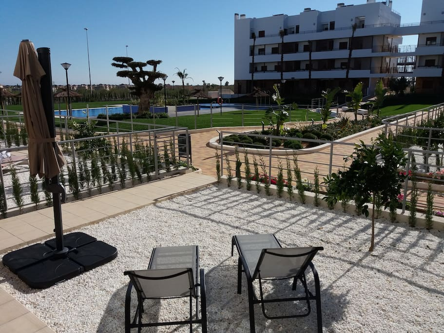 Tuin/terras met toegang tot pool area