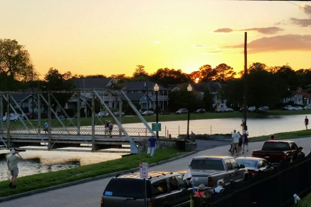 Lots of activities are happening on Bayou St. John!  This view of the historic bridge was taken from our front porch in the evening.