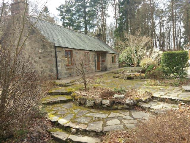 Historic Torphins Cottage amongst woodland