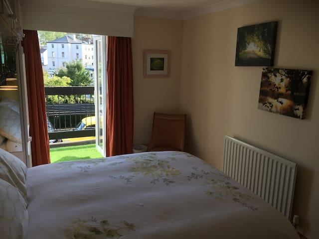 Your en-suite bedroom is a quiet haven considering it's central location. The double bed is new and the room looks out onto the balcony, communal garden and river beyond.