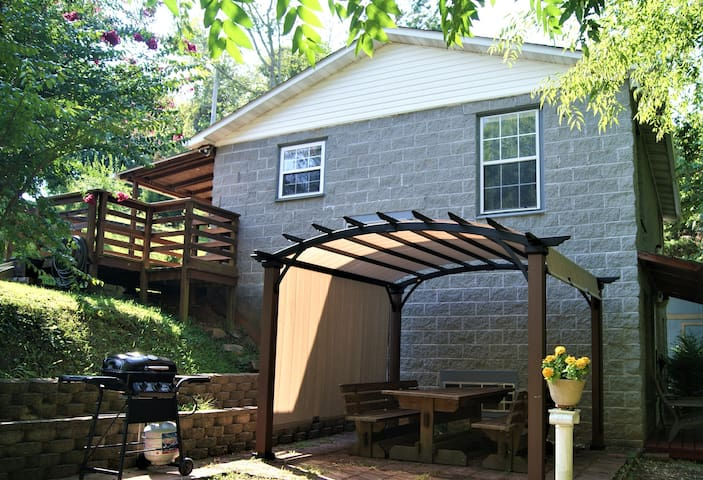 Shared patio with pergola, picnic table and gas grill