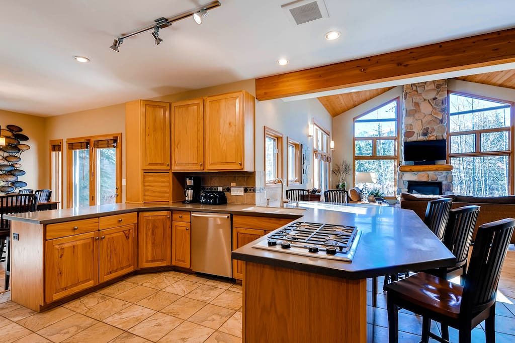 Kitchen with gas cooktop, bar seating and opens into Living Area and Dining - great open floor plan!