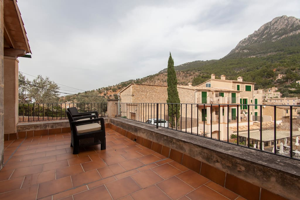 Stunning mountain views await from the top terrace.