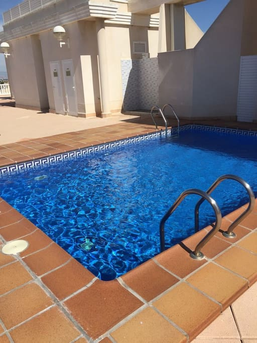 Beautiful rooftop pool with seating ,sun beds ,showers and wonderful views