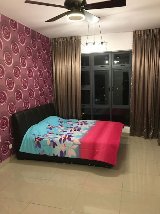 "Comfortable master bedroom with own attached toilet and 32"" TV (extra mattress can be arrange)."