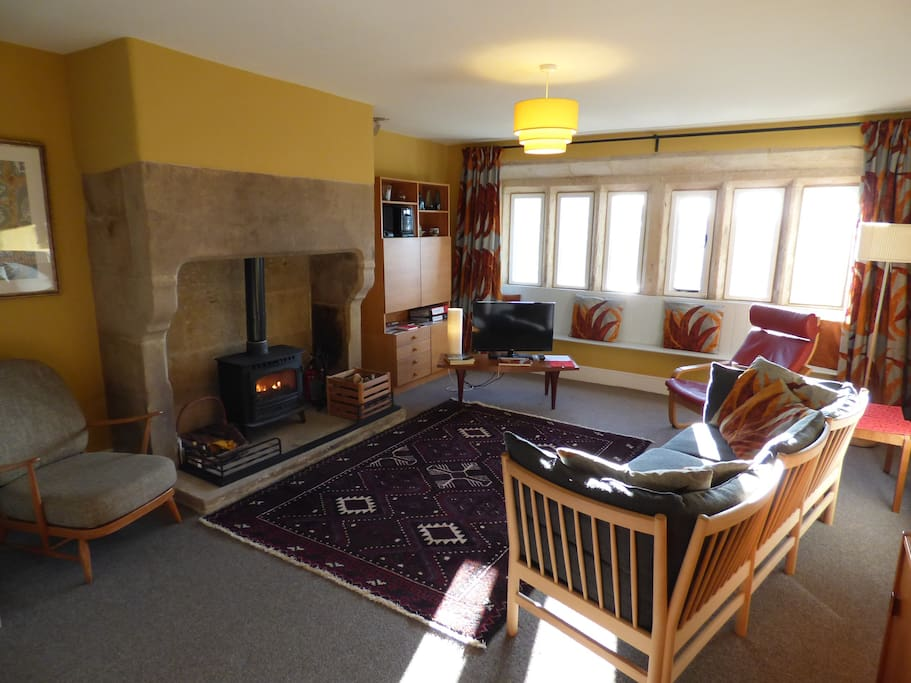 Super-cool and super-cosy Elmet Farmhouse with huge carved stone fireplace and wood-burning stove