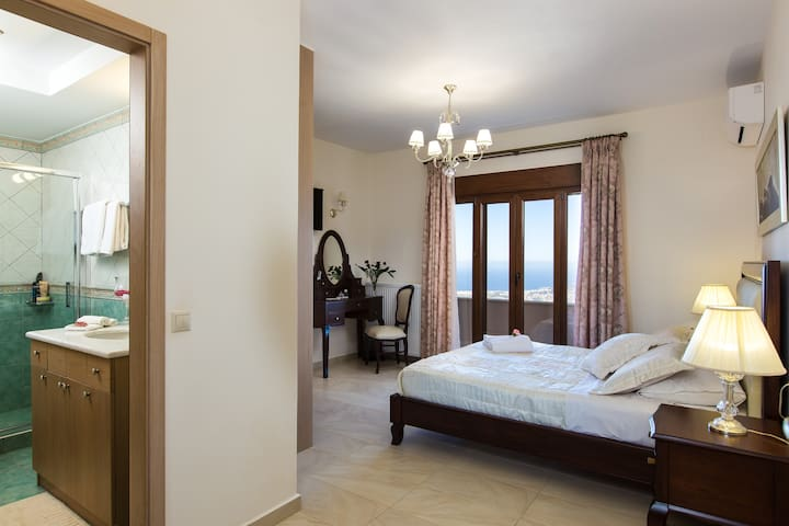 The master bedroom with en-suite bathroom on the first floor