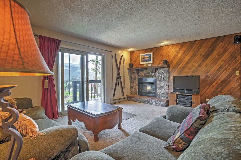 Relax in the living room with a fireplace and flat screen cable TV.