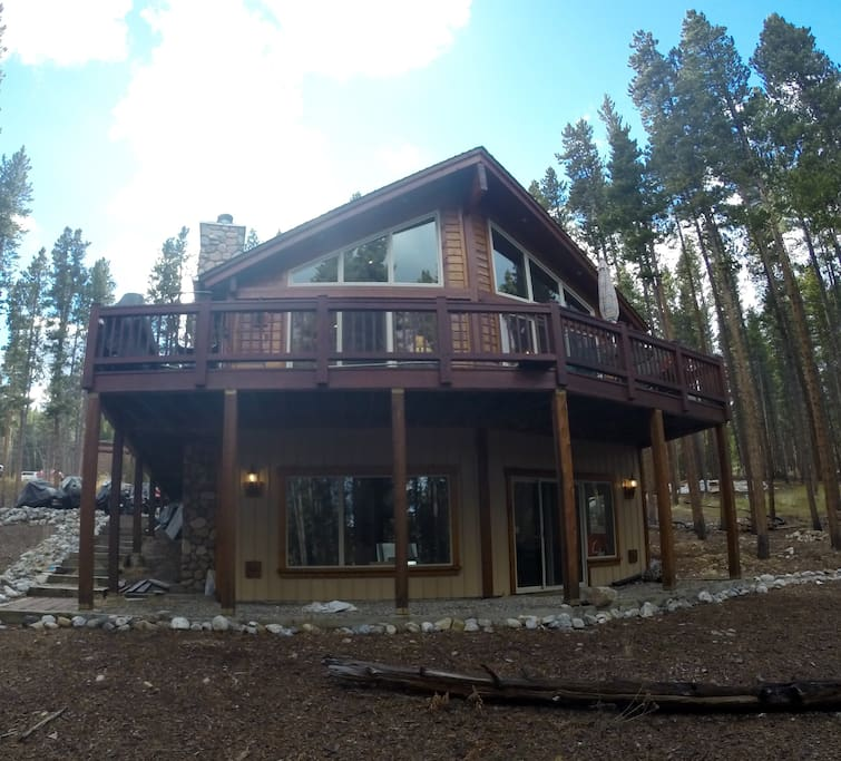 A front deck which overlooks the National Forest adds to the chalet style architecture of the home.