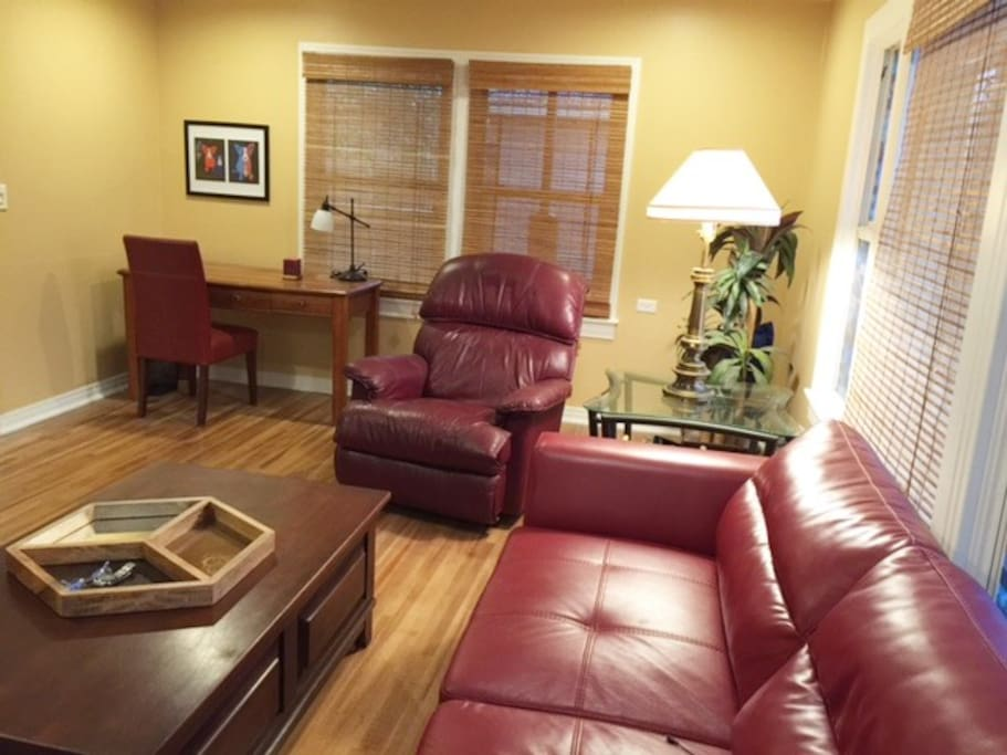 Lounge has oversize sofa, recliner and desk
