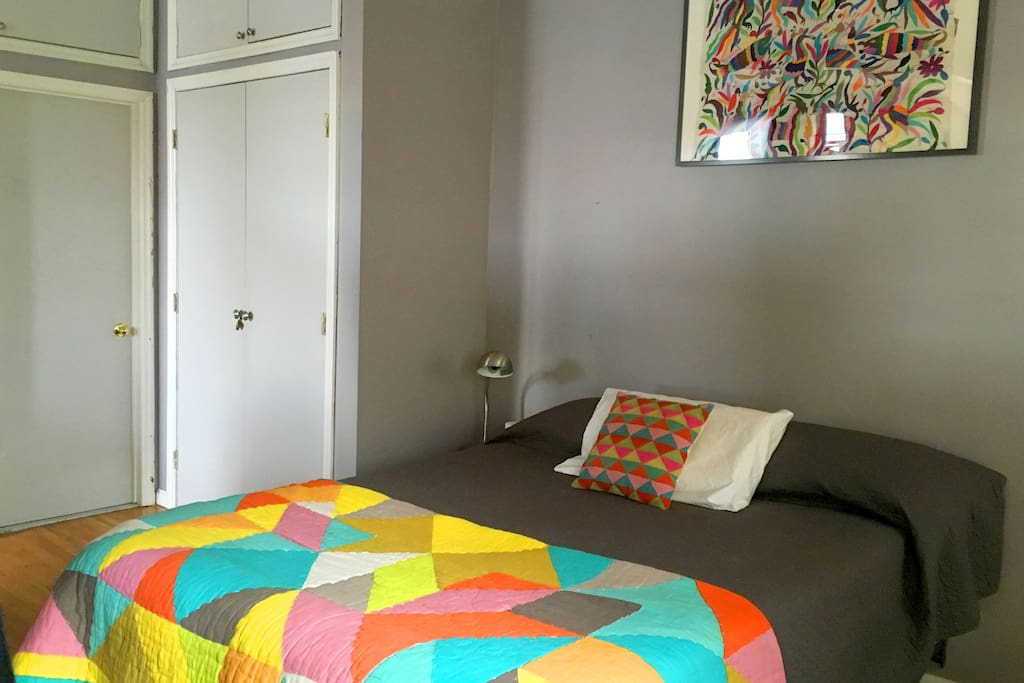 confortable and full of natural light bedroom. sommier bed.