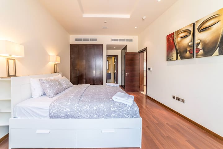 Master bedroom with woodier floors