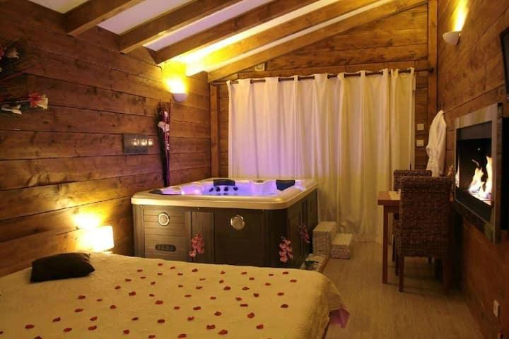 chambre romantique avec jacuzzi et cheminée