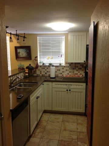 Kitchen as you are walking into condo.