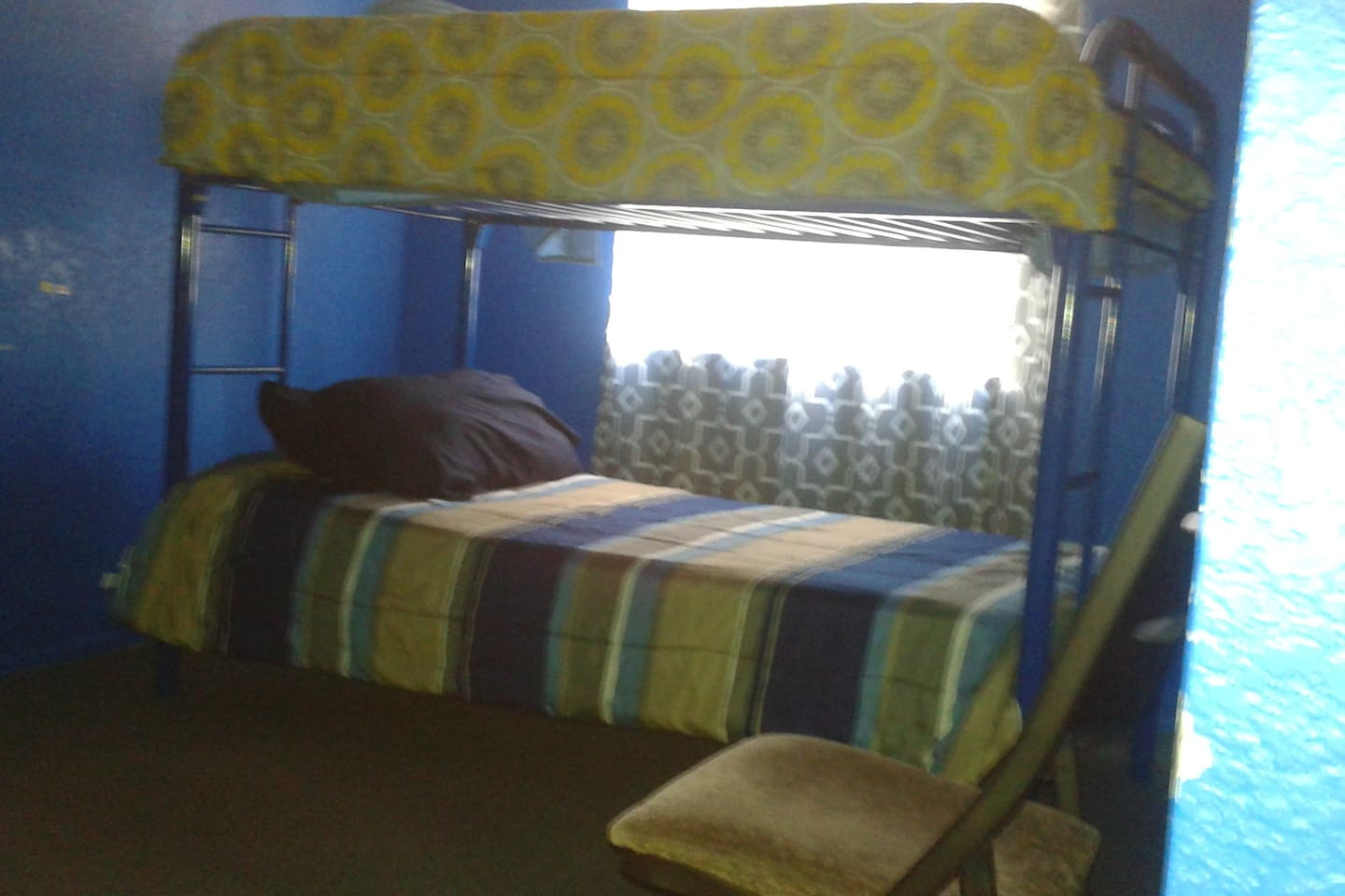 Must note there are 3 total beds in this room. Bunk beds and a single day bed.