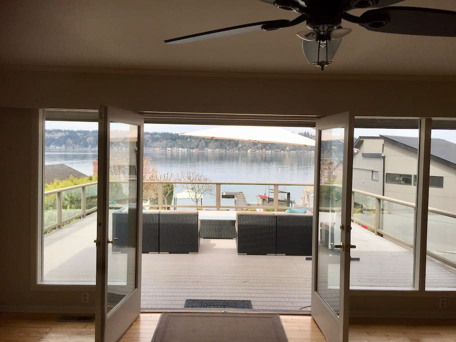 Large deck off kitchen of your 2800 SF space with views of the lake (plus access below).  Watch the bald eagles soar in nearby trees.  Enjoy all this property has to offer.