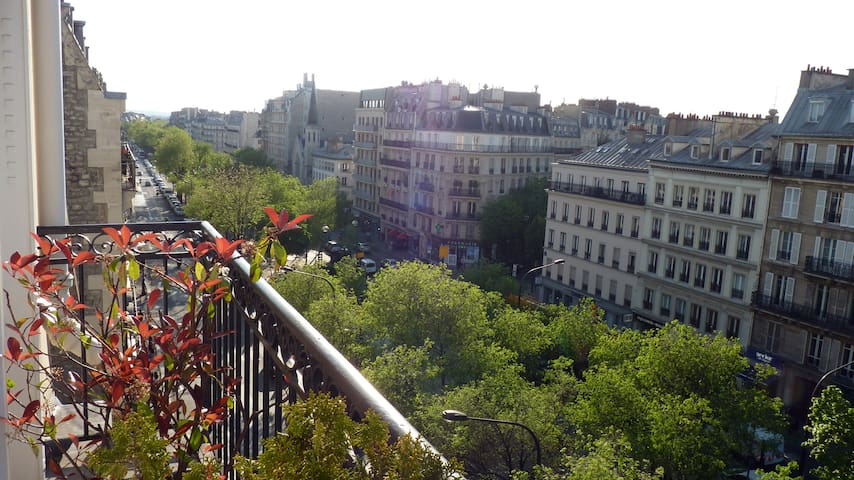 From the balcony, overlooking the boulevard where the organic farmers market takes place every we