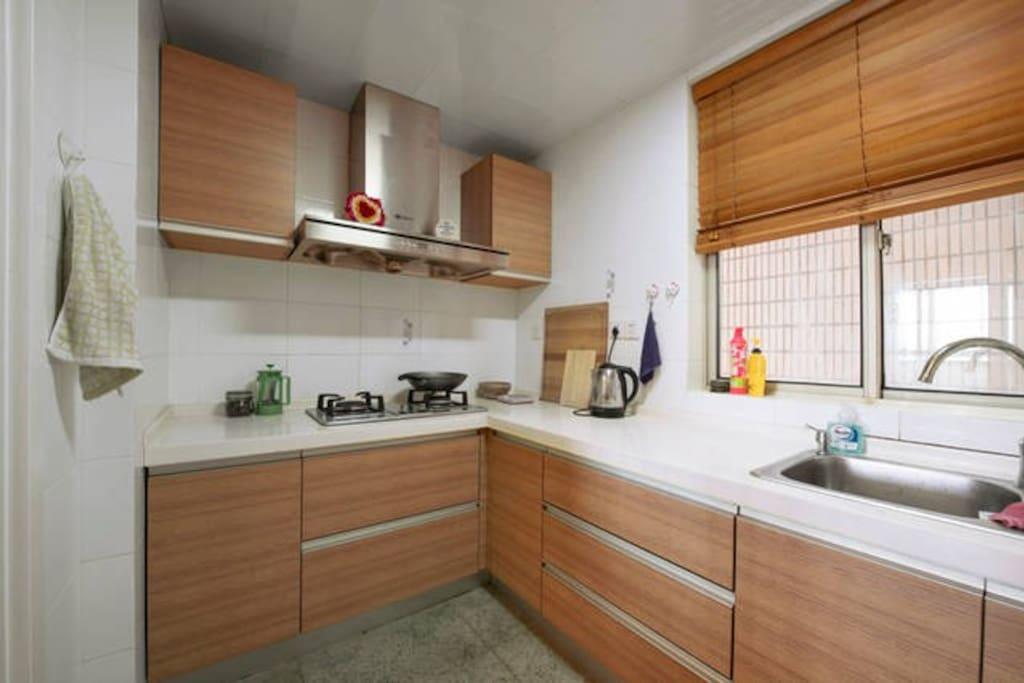 Kitchen with microwave, pots and pans, and refigerator/freezer.