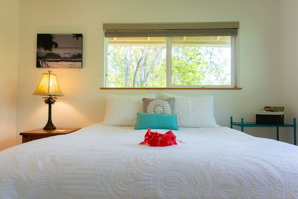 Haleakala master bedroom, queen size bed with comfy mattress cover and private bathroom/shower
