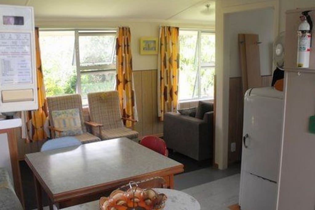 Open plan living, kitchen and dining area Kiwi Classic - Matapouri Holiday Home