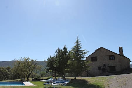 Mountain Cottage with good views, pool and BBQ.