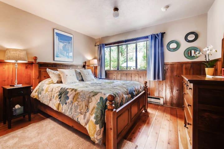 Comfortable Queen bedroom with beautiful view of huge back yard, deck & giant trees