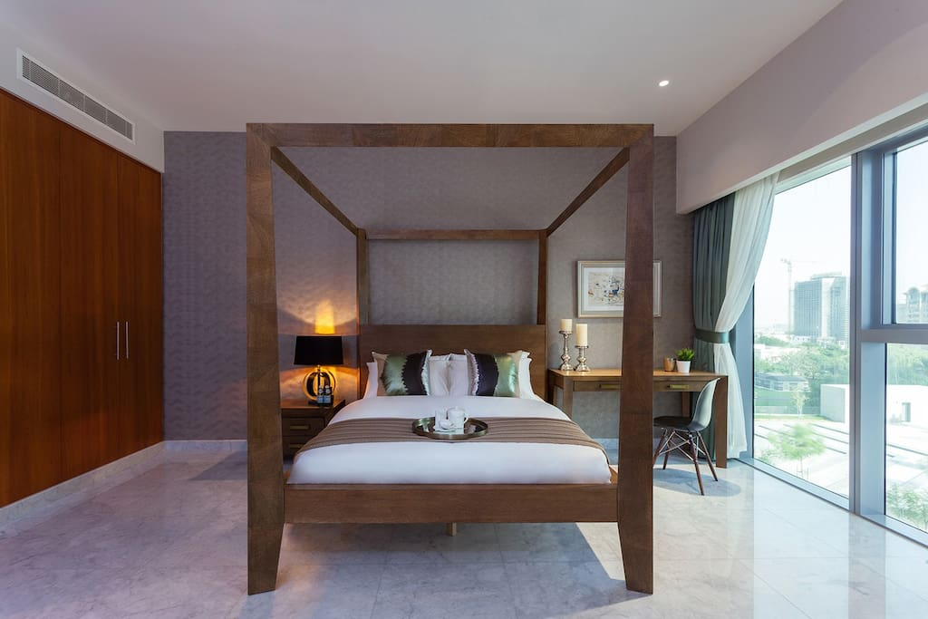 Luxurious four poster bed with pool view
