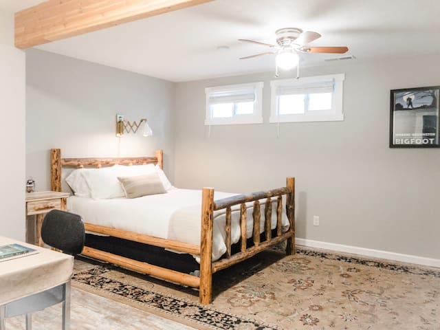 Enjoy a restful night's sleep in our Northwestern hand-made log bed.  The suite is complete with an attached bathroom with bidet and jet tub, a spacious walk-in closet, secondary closet, bookshelf full of good reads, and desk for your mobile office.