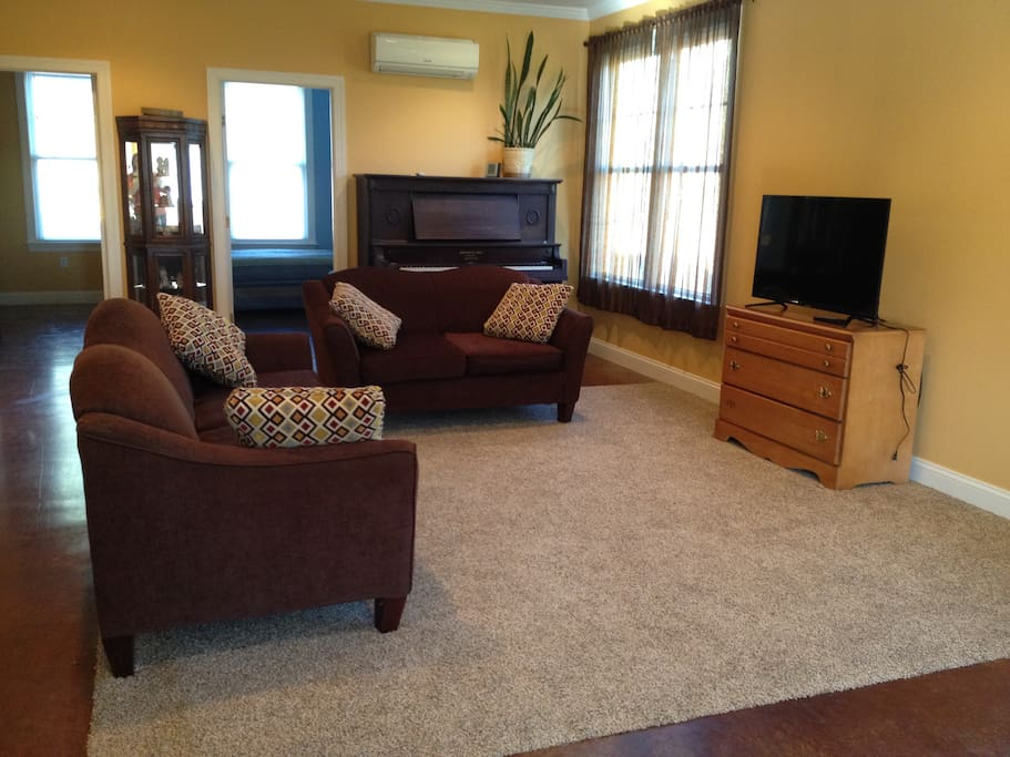 We have a large living room area with wifi and satellite TV.  Enjoy lots of sunlight through the windows in the morning hours!