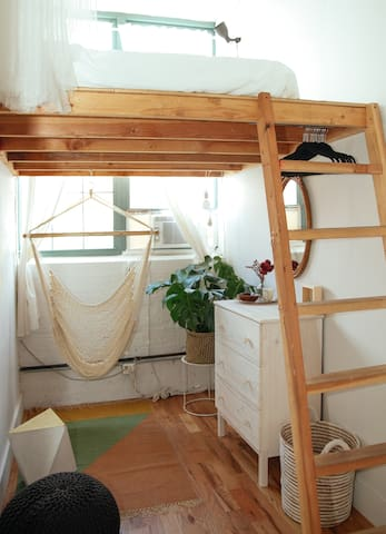 The lofted bed on top. AC is installed on the windows during the summer to keep you cool.