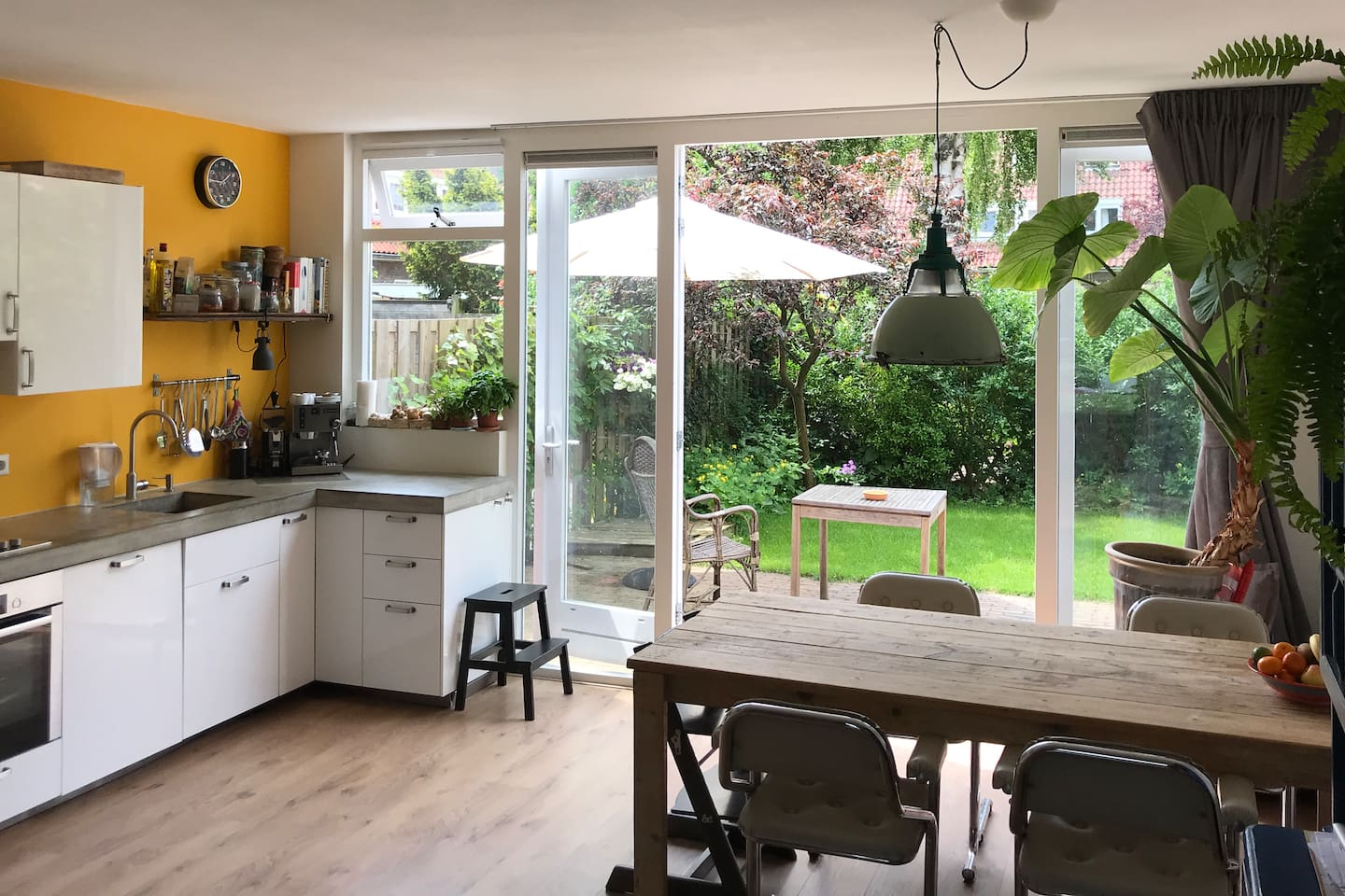 Light open kitchen with two doors that open to our green and sunny garden.