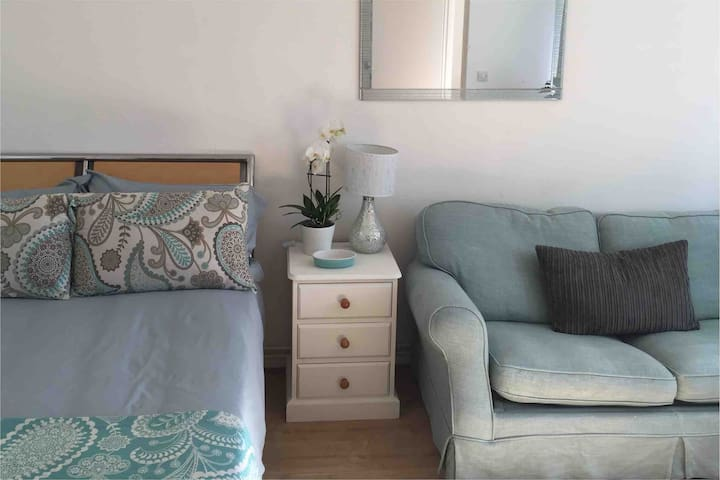 Double bed & double sofa bed in the bright studio apartment