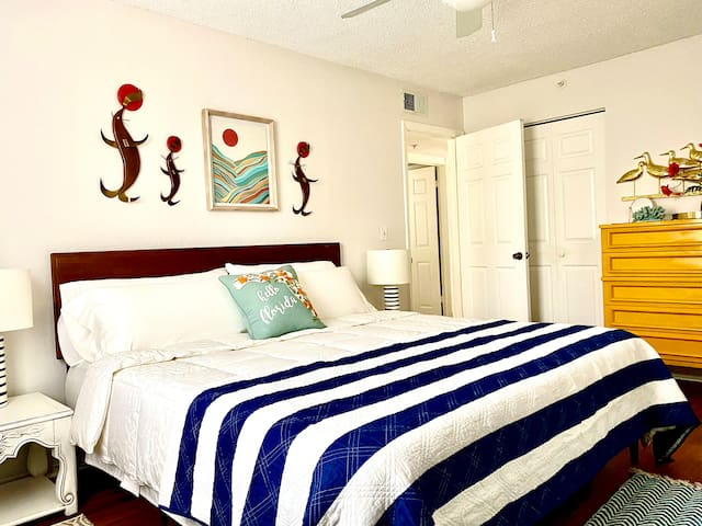 Fun, yet relaxing, master bedroom with a comfy king-size bed