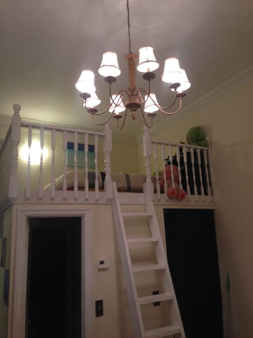View up to loft bed.  Bathroom and apartment entrace door are built in under the loft.  Great use of space.