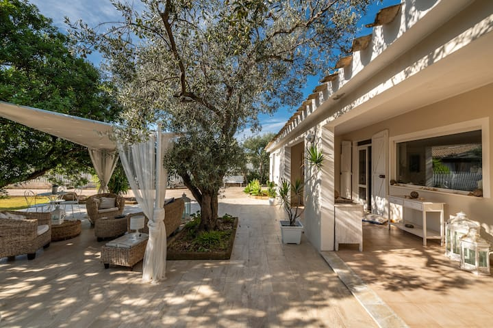 Modern Villa Maria Beatrice with Large Garden, Terraces, Air Conditioning & Wi-Fi; Parking Available on the Property