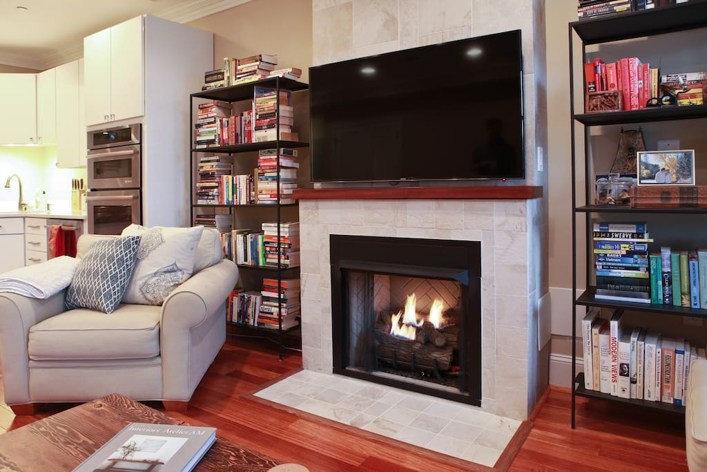 Living room with flat-screen TV and functioning gas fireplace