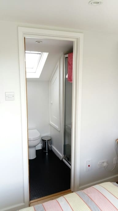 Smart en-suite with shower and lovely view from the velux window.