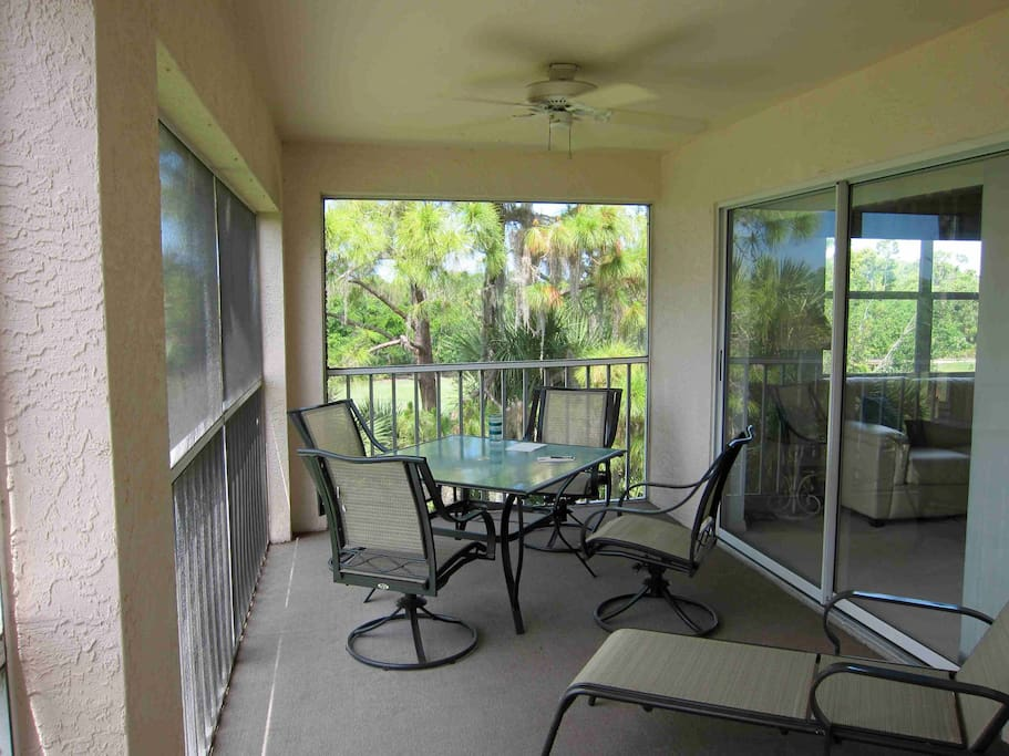 Relax outside in the screened lanai.