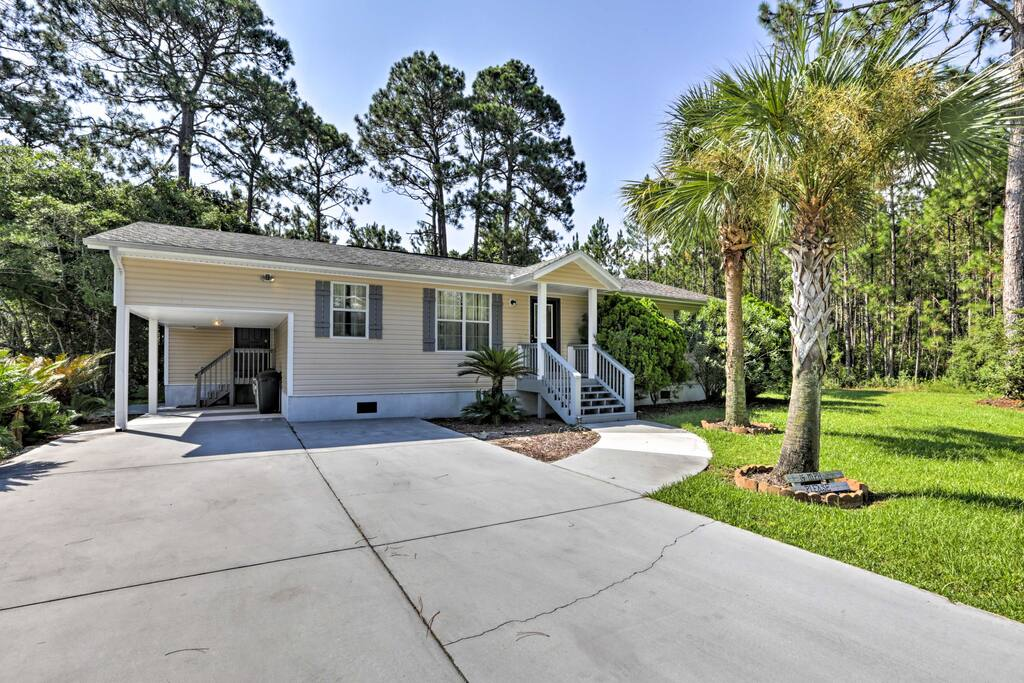 This charming home sits just half a mile from the beach!