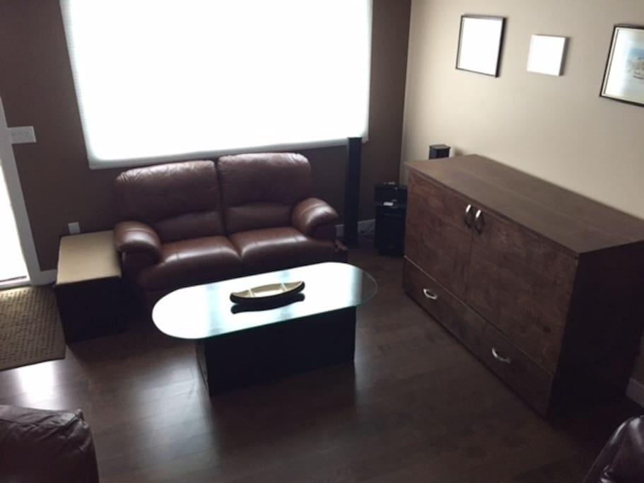 All leather furniture and hardwood floors