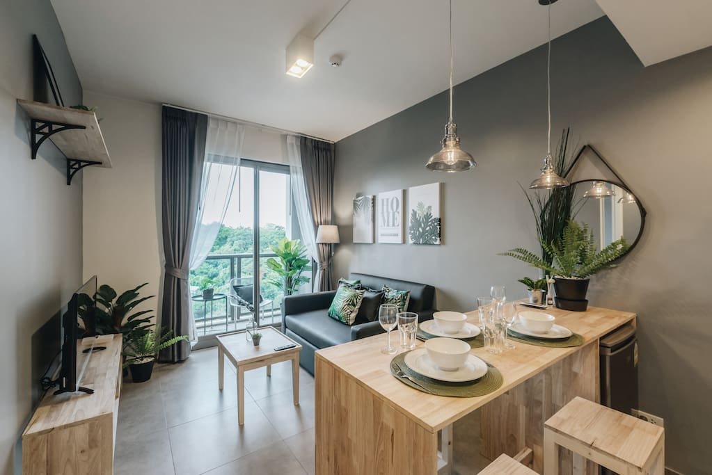 Stylish Green Loft Living Room with Dining table
