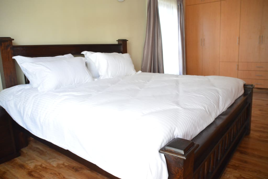 King size indigenous hard wood bed with cotton linen
