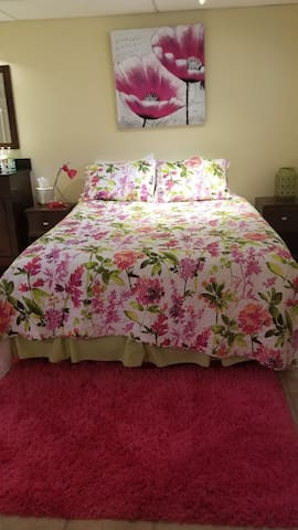 Queen bed with linens for the season