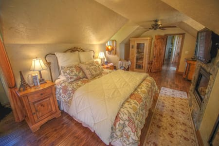 Main suite of two-bedroom suite in Star of the North. 1250 sq. ft total with large private deck overlooking Lake Mayfield.