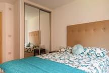 Main bedroom with built in storage and ensuite