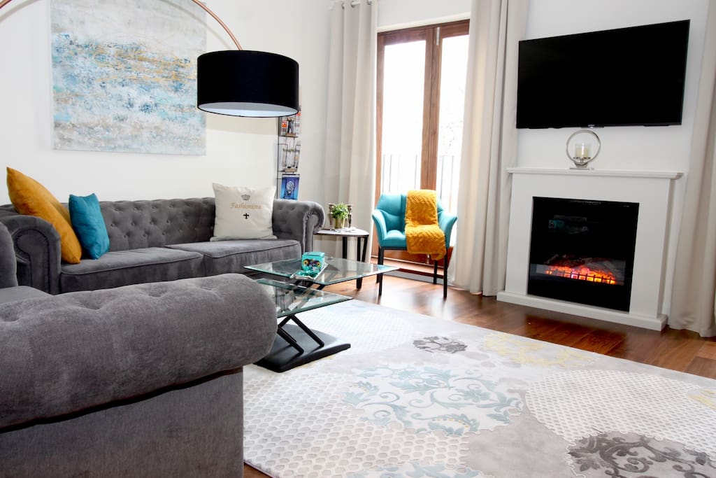 Bright living room with fire place.